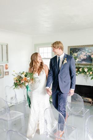bride and groom indoor ceremony in the details byron center truer design