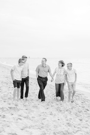 family of 5 walking on the beach teen boys Lake Michigan South Haven Michigan