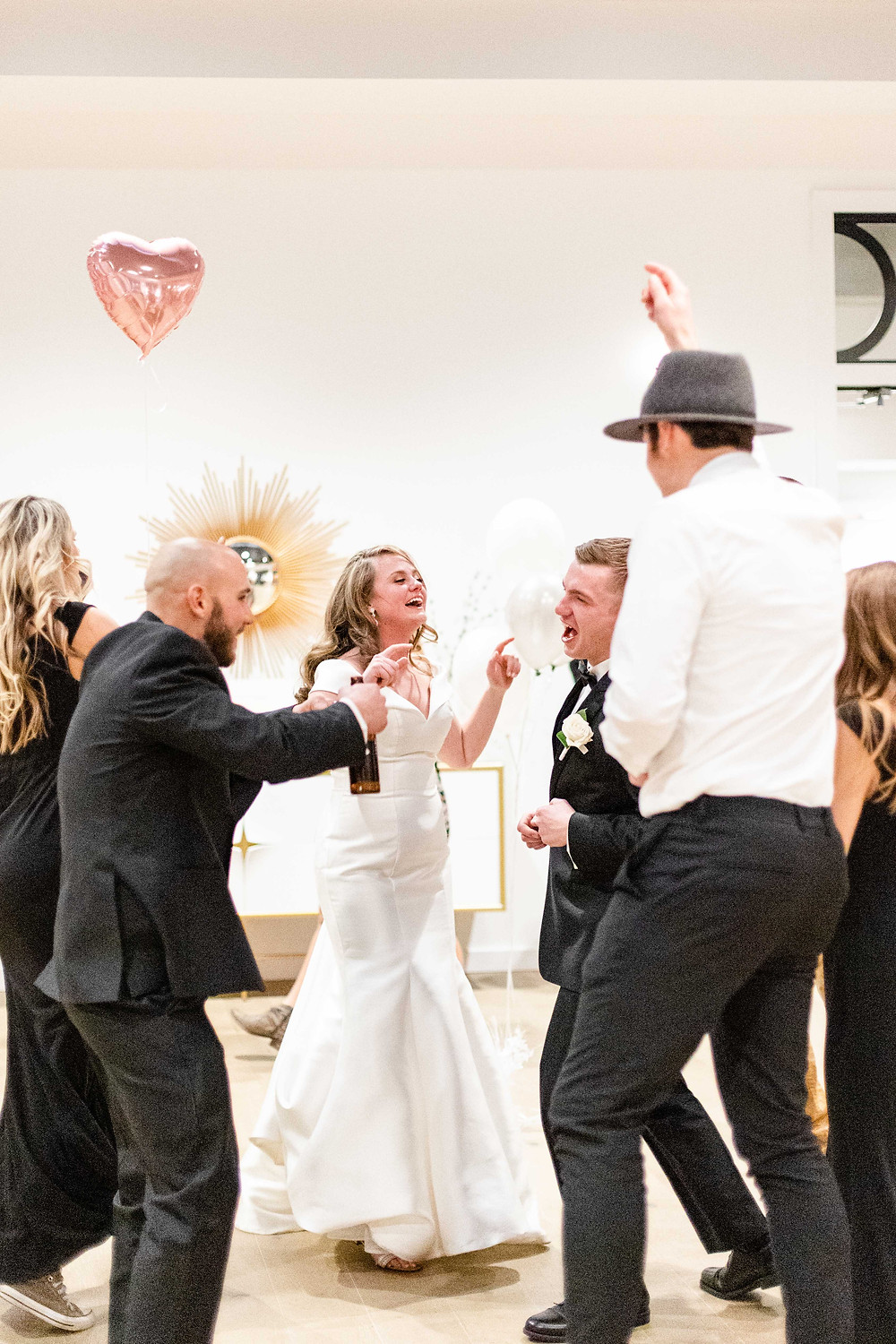 Josh and Andrea wedding photography husband and wife photographer team michigan venue Bay Pointe Woods shelbyville snow winter wedding reception bride and groom guests dancing