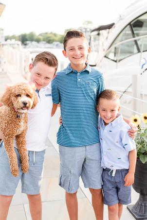3 boys and dog by yacht boat new buffalo michigan