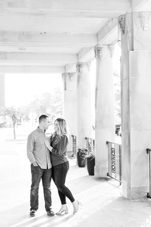 Engagement Photos Downtown Saint Joseph MI cute couple standing under pillars