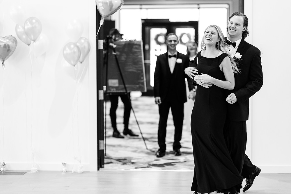 Josh and Andrea wedding photography husband and wife photographer team michigan venue Bay Pointe Woods shelbyville snow winter wedding black dress suit groomsmen bridesmaid