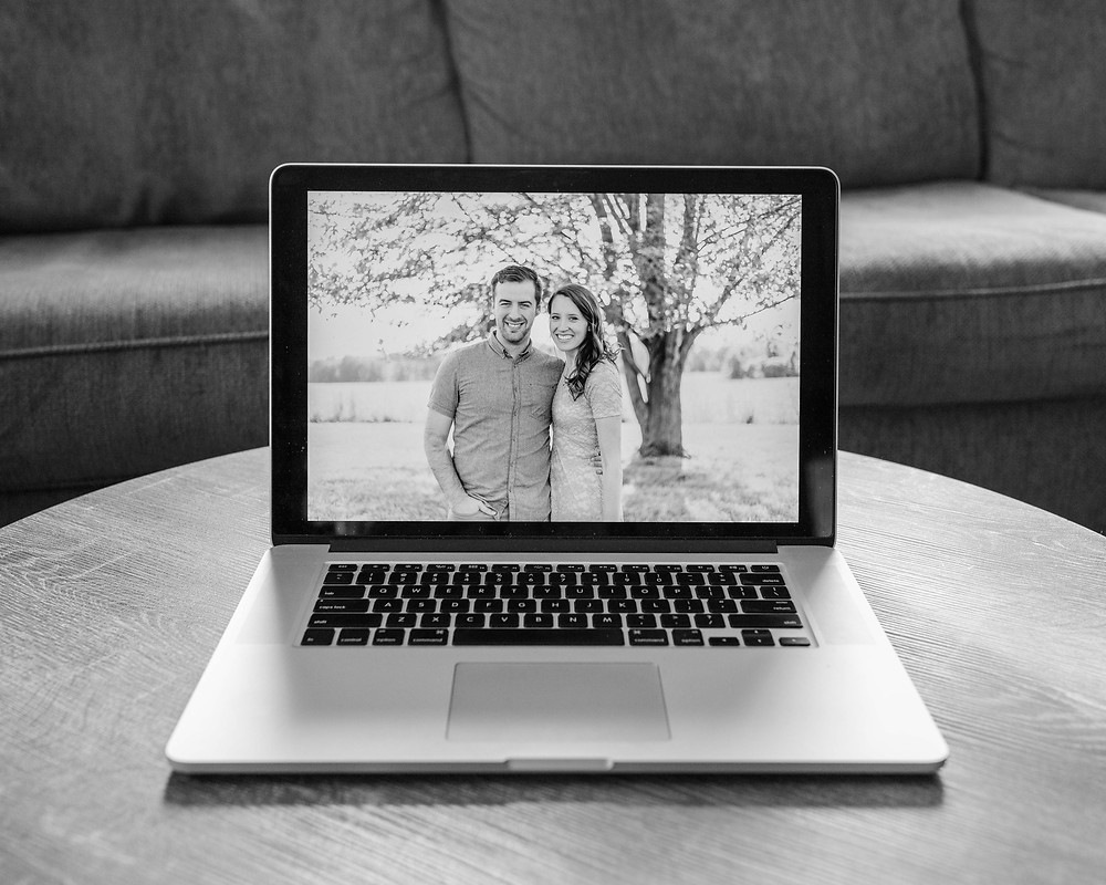 Picture of man and woman on apple laptop