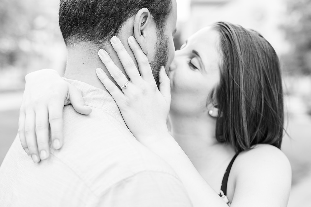 Josh and Andrea wedding photography husband and wife photographer team michigan pictures university notre dame engagement pictures session photo shoot fiance kissing ring shot