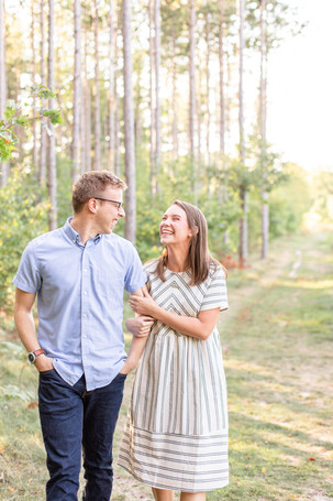 Engagement Photos Riley Trails Holland Michigan Engaged Couple walking smiling