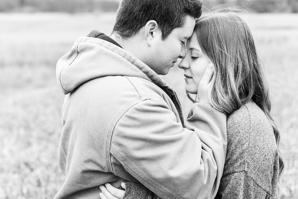 josh and Andrea photography husband and wife team michigan engagement photo shoot al sabo land preserve man and woman touching foreheads