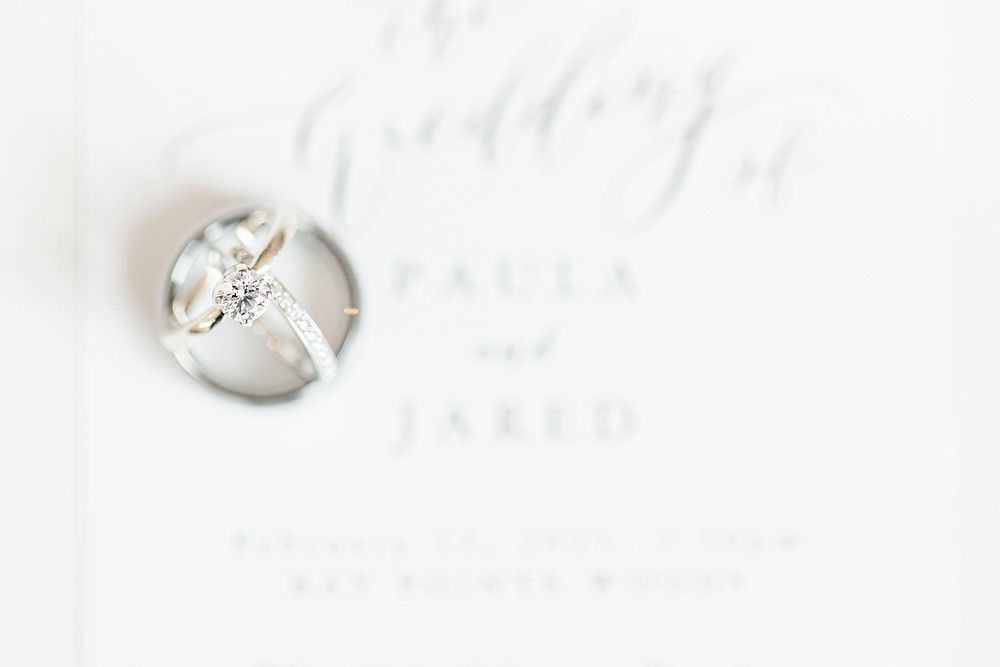 Josh and Andrea wedding photography husband and wife photographer team michigan venue Bay Pointe Woods shelbyville winter wedding ring shot