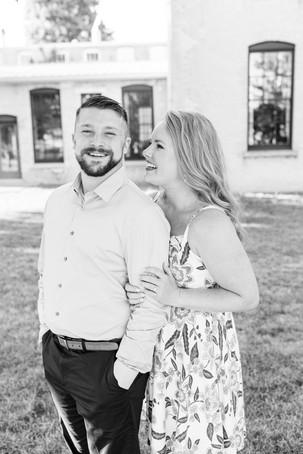 engagement photos couple laughing journeyman distillery weddings three oaks michigan