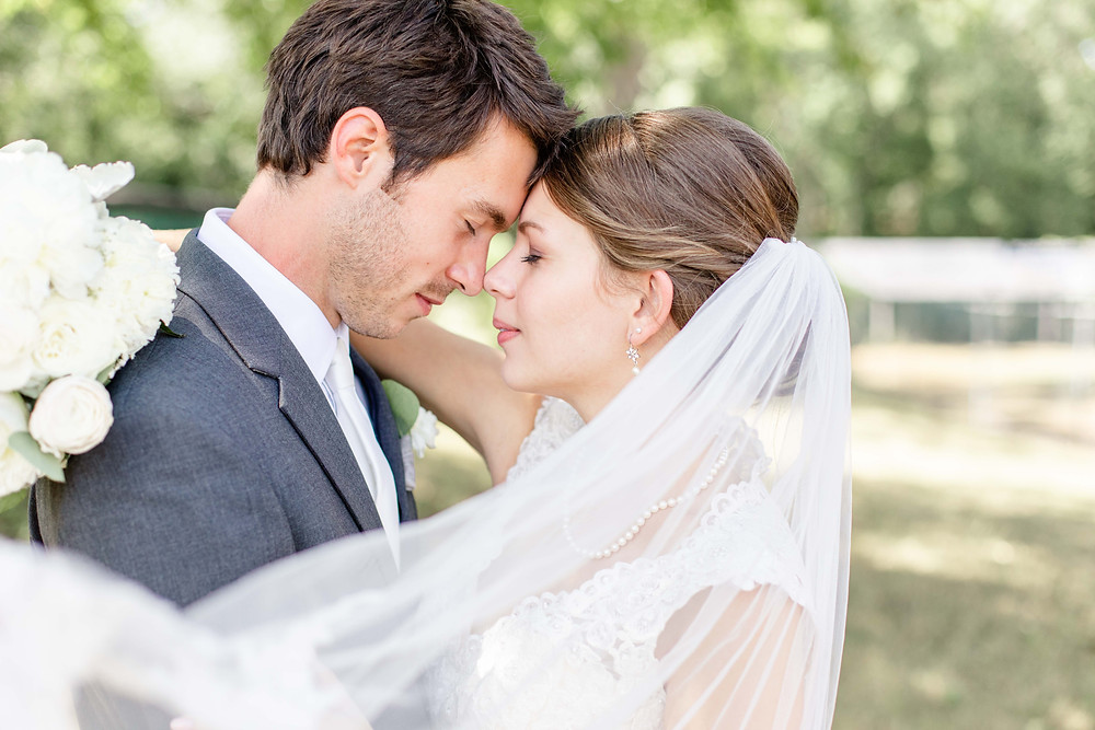 bride and groom forehead to forehead veil across front Milledgeville Georgia