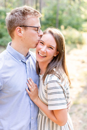 Engagement Photos Riley Trails Holland Michigan Engaged Couple kissing and smiling
