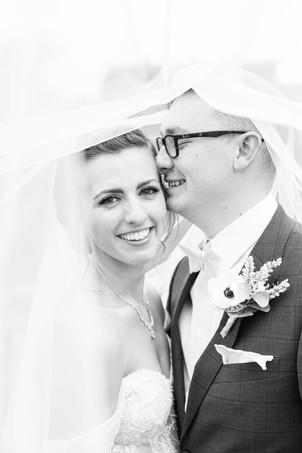 Bride and Groom under the veil photo Saint Patricks Park South Bend Indiana