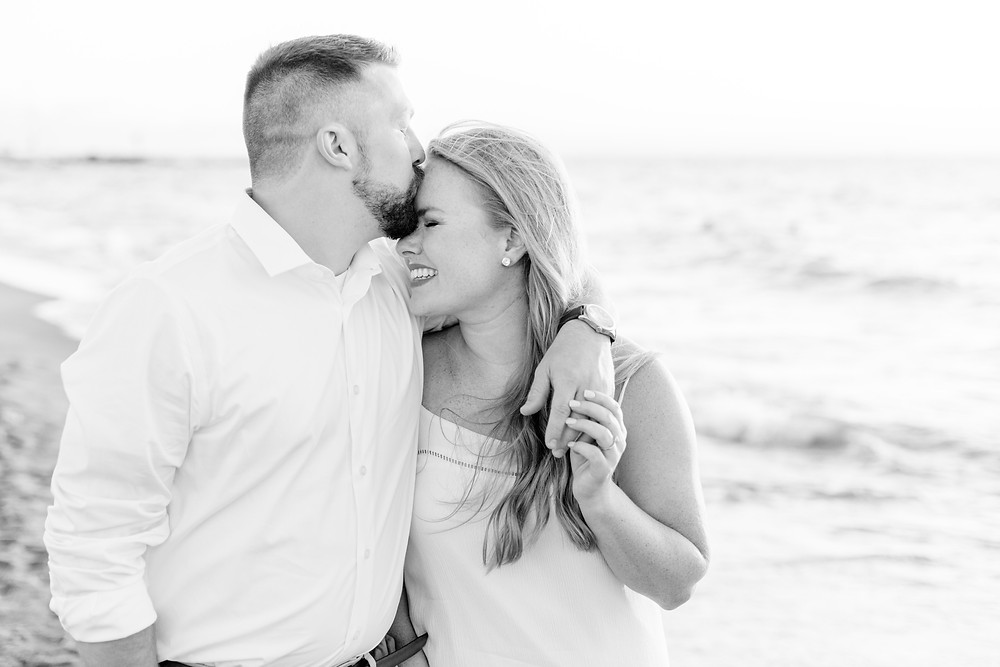 white dress engagement photos cute couple on city beach new buffalo michigan