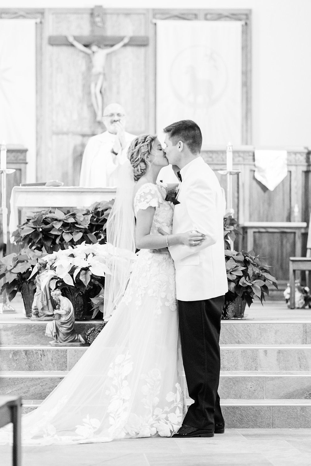 josh and Andrea photography husband and wife team michigan winter wedding south haven st basils bride and groom first kiss front of church