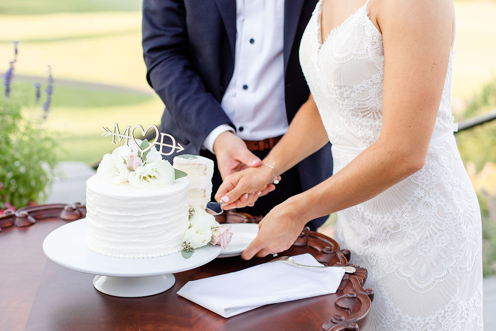 bride and groom cutting cake reception Kent Country Club Wedding Grand Rapids