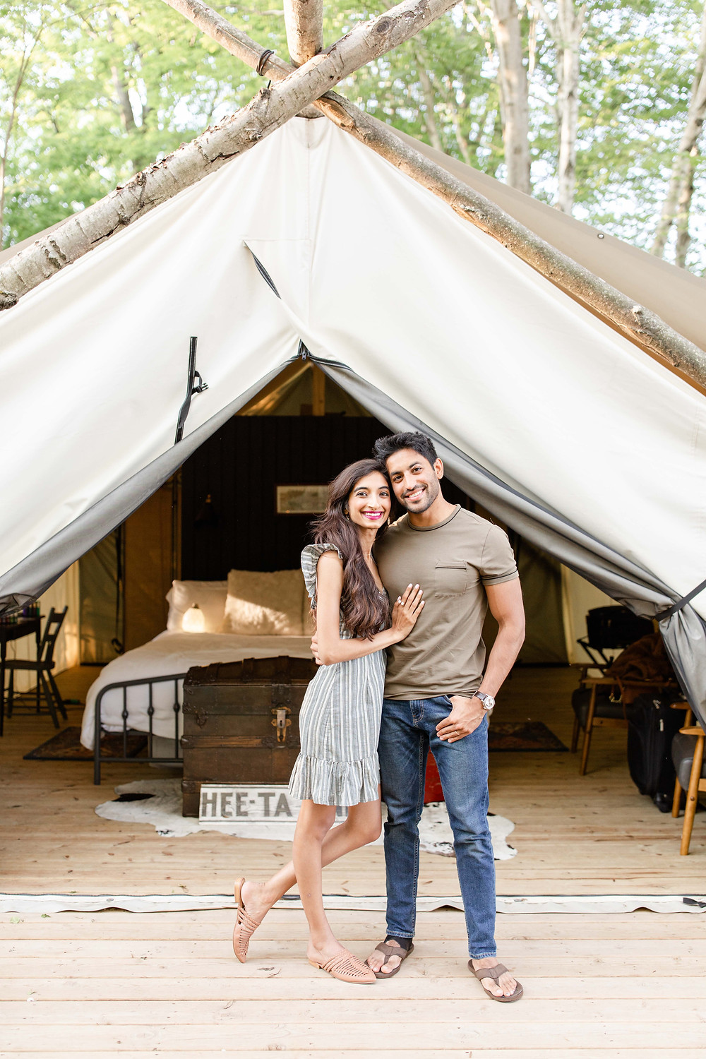 cute couple standing in front of tent The Fields of Michigan South Haven luxury glamping experience