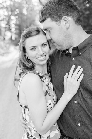 engaged couple standing tender moment Something Blue Berry Farm Wedding Venue