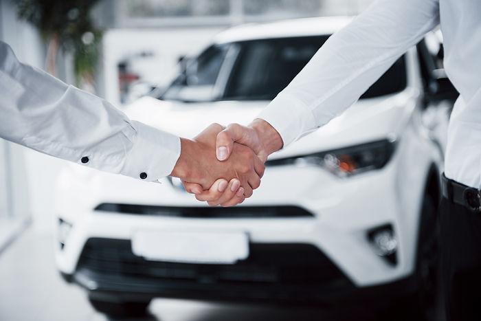 close-up-sales-manager-black-suit-selling-car-customer.jpg
