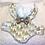 Thumbnail: Manteau sapins dorés avec noeud