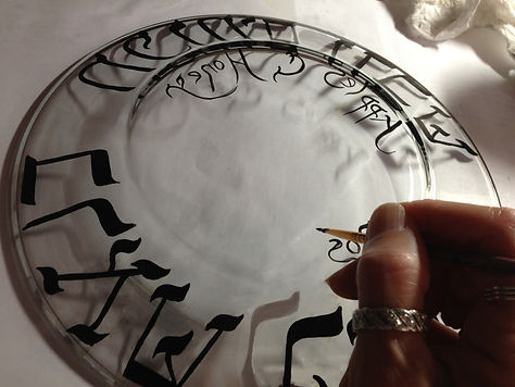 logo hand on plate clean.jpg