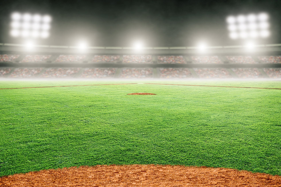 Baseball field at brightly lit outdoor stadium. Focus on foreground and shallow depth of f