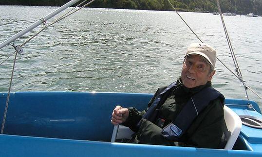 Disabled sailor enjoying the river dart wit dart sailability