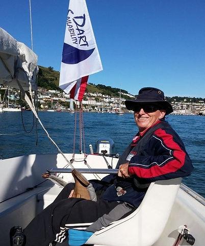 Disabed sailor enjoying sailing sornar of the dart with dart sailability
