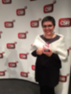 Olga Ivannikova receiving the Internatonal CSR Excellence Award for Private Goodness