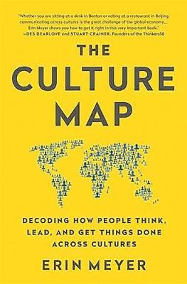 Yellow book cover 'The culture map: decoding how people think, lead, and get things done across cultures' by Erin Meyer. A picture of a map of the world