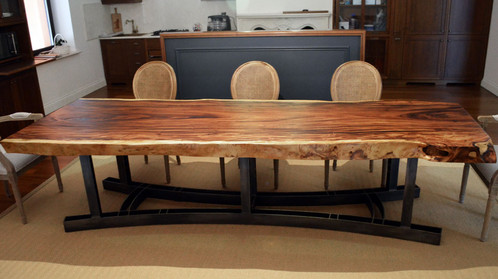 A Large Dining Table Is Made Of Whole Array Suar Wood With Live Natural Edge