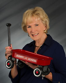 Lee Knapp an her little red wagon