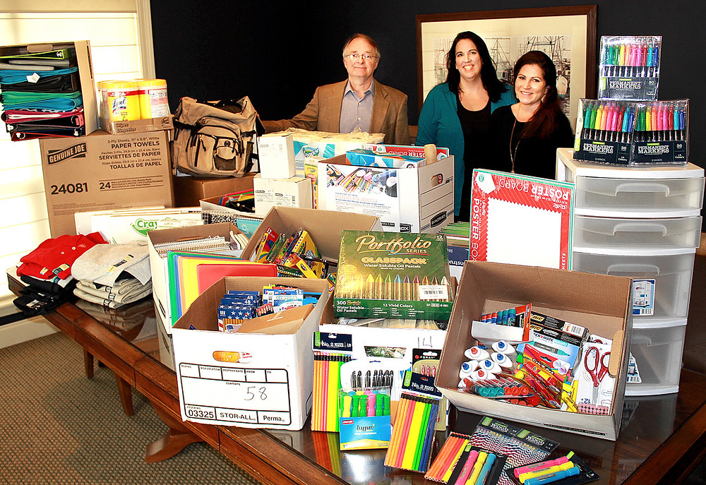 Local Personal Injury attorney Brehm Bell donates school supplies