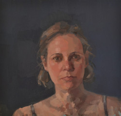 Self portrait with dark blue background.