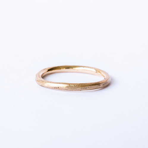 Simple rough band in 14k yellow gold