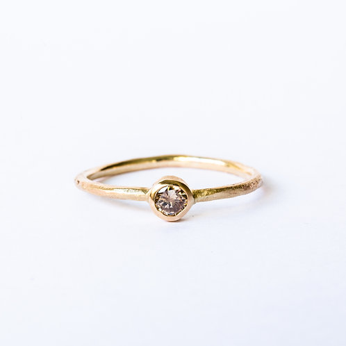Chocolate diamond ring on rough gold band