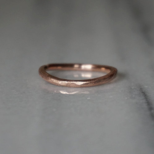 Simple rough gold band ring in 10k rose gold