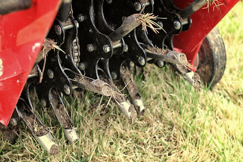 Close up of a mechanical lawn aerator..j