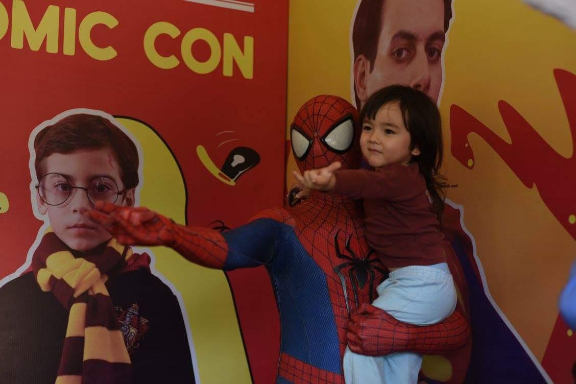 Cosplayer Gaurav Thakur holdin a kid