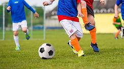 Children-Playing-Soccer-Footba-115642769