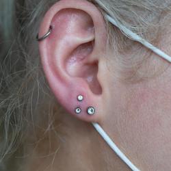 Bri Tri piercing