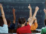 Kids hands up school.jpg