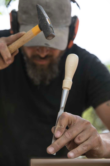 Greg chiseling wood