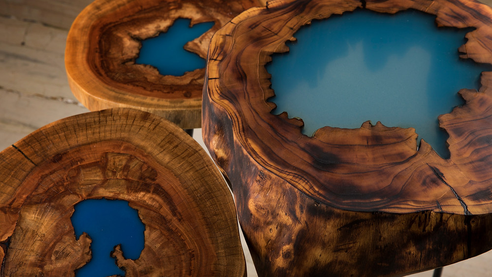 Salvaged and repurposed blue lagoon wood tree trunk table with resin filling made by Barreto Outdoors in India.