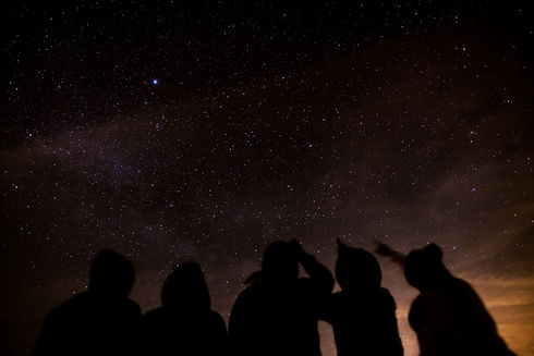Silhouette of a group of friends stargaz