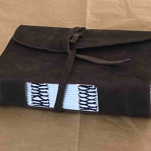Caderno costura cruzada