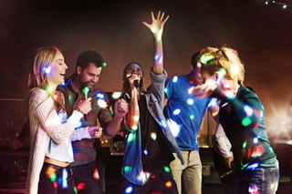Group of young adults singing karaoke