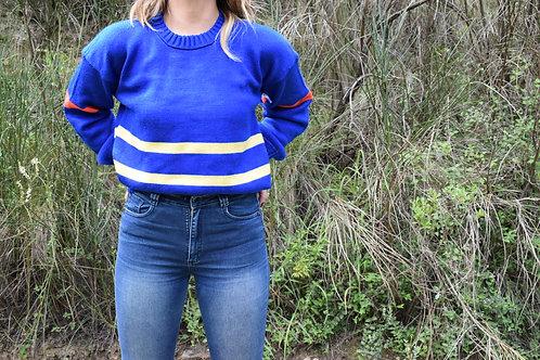 Suéter azul rey con combinación de lineas