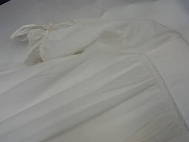 Conservation treatment on a christening gown