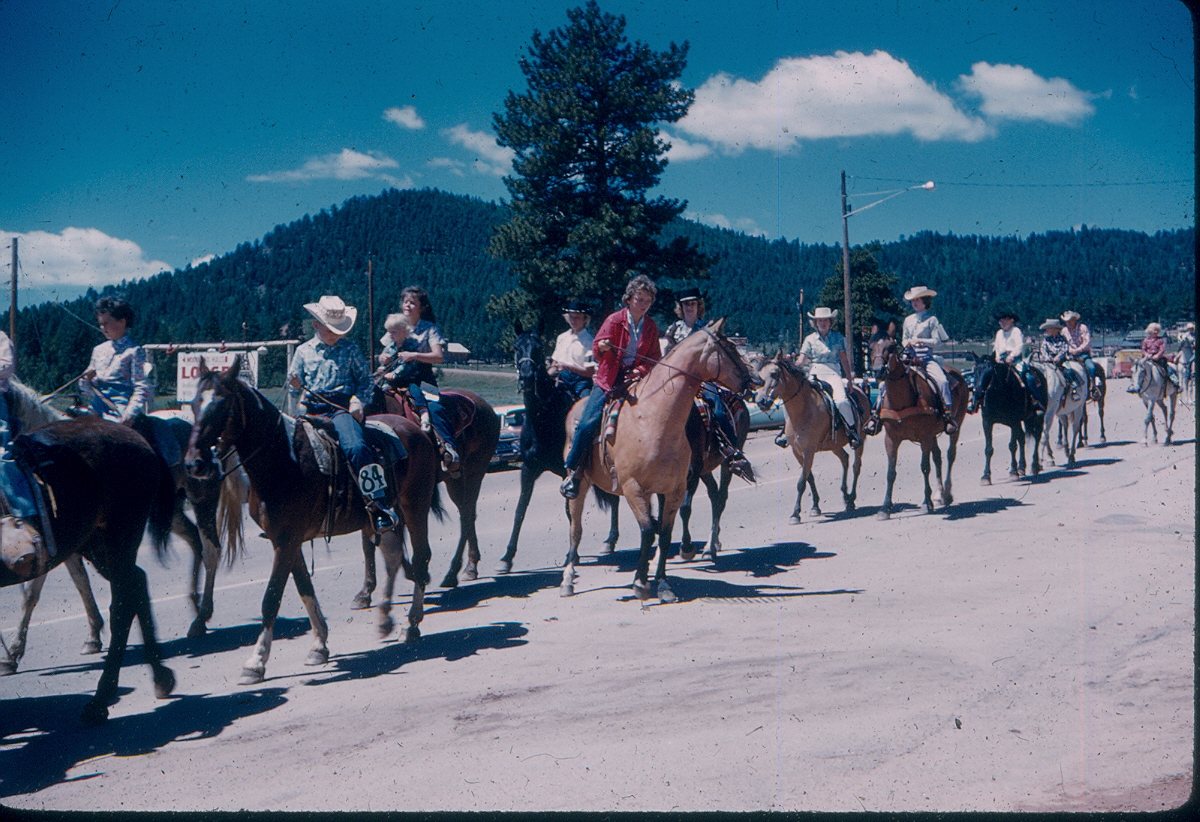 rodeo parade 1961 Barbara B. holding kid and Sally Bohenna on buckskin, red jacket