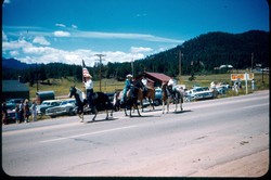 rodeo parade 1961 Bert Bergstrom with the flag Queen & Aides, Nanette Bohenna on paint