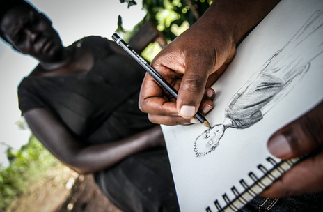 Female former child soldier describes events to artist
